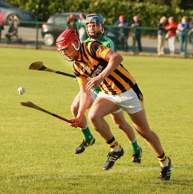 Peter Travers (Naomh Eanna) moves in on Conor Hearne (Shelmaliers)