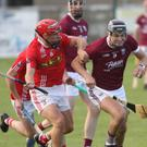 Jack O'Connor of St. Martin's is tackled by Fethard's joint captain, Garrett Foley