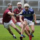 Rowan White of Glynn-Barntown under pressure from Paudie Kelly and Aaron Maddock (St Martin's)