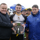 Askamore captain Darragh Kinsella with Declan Kenny of sponsors Greenstar, and his clubmate, Coiste na nOg Secretary David Tobin, who was representing the County Board