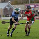 Aidan Rochford of St. Anne's is challenged by Rapparees defender Jack Kelly