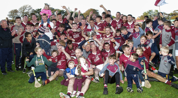 The Castletown crew celebrating Sunday's impressive county final victory with some of their youngest supporters