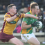 Bryan Cody of Rathgarogue-Cushinstown holding off Craobh Chiaráin's Stephen O'Brien