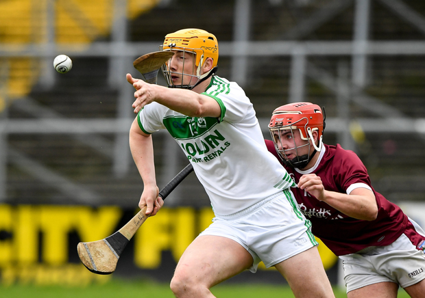 Eoin Reid of Ballyhale Shamrocks making tracks away from St. Martin's defender Eoin O'Leary