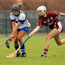 Sarah O'Connor of St. Martin's tries to flick the ball away from Deirdre Johnstone (St. Vincent's)
