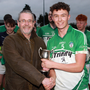 Daniel Dempsey receives the trophy from Rory Murphy (Chairman)