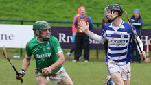 Alan Carton of Cloughbawn on the ball, with Naas defender Rian Boran close at hand