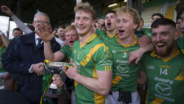 Matthew Cody receives the trophy from Pat Teehan, Vice-Chairman of the Leinster Council