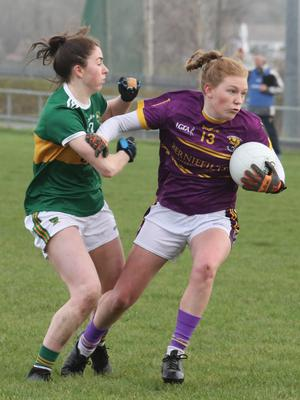 Ailis Neville is tackled by Kerry's Aislinn Desmond