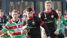 Enniscorthy's Ivan Poole makes a break, with Nick Doyle on hand if support is needed