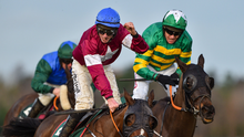 Jack Kennedy on Roaring Bull celebrates after nabbing Barry Geraghty on Paul Nolan's Fitzhenry in the big race at Leopardstown