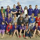 The successful members of the Wexford 'Nippers' Lifesaving team, with Coach Lar O'Connor.