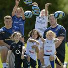 Leinster rugby players Michael Bent and Jack McGrath with children at the Gorey Summer Camp.