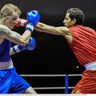Dean Walsh, Ireland, left, exchanges punches with Abdel Malik Ladjali