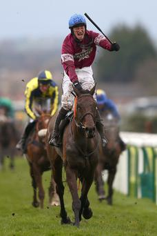 David Mullins celebrates winning the Crabbie's Grand National on Rule The World
