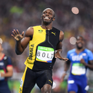 A beaming Usain Bolt celebrates after winning the 100 metres final