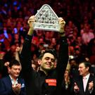 Ronnie O'Sullivan lifts the Paul Hunter Trophy after beating Joe Perry in the final of the Masters