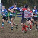 Jack Curley bursting through the Mullingar defence in Gorey Under-14s' rugby win on Saturday.