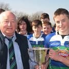 Gorey President Frank Deering presents the cup to team captain Brian Cushe