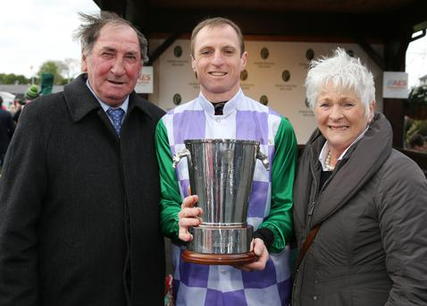 Jamie Codd celebrating his first champion amateur title with his parents, Billy and Mary Frances. Photograph: Dave Barrett.