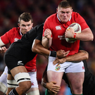 Tadhg Furlong is tackled by Jerome Kaino and Codie Taylor of New Zealand