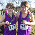 United Striders colleagues Myles Hewlett (second) and Cosmo Hewlett (eleventh) with their medals after the Under-13 race