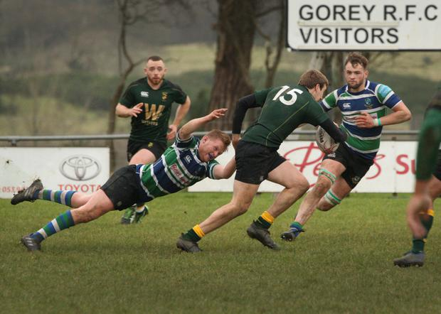 Eoghan Duffy of Boyne eludes the diving tackle of Gorey's Fergal Bolger, but Jordan Aherne has the full-back in his sights