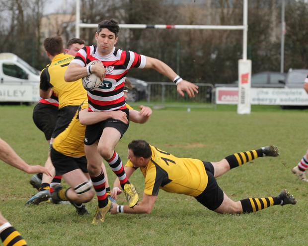 Enniscorthy's Ivan Poole evading an Ashbourne tackle during Sunday's top of the table clash