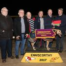 Likeable Light, winner of the recent Henry Kelly A4 575 Stake final, with Paul Cahill, John Hand, Andy Hand, Frank Rennicks, John Brady (owner), Henry Kelly (sponsor) and Ed Carroll
