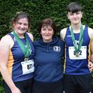 Amy and Jack Forde (St. Killian's) with their proud mother, Anne-Marie, the Wexford Athletics Secretary