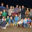 The presentation following The Horse and Hound Tridistance Sweepstake final, won by 'Karlow Eddie' at Enniscorthy Greyhound track on Monday night. Brendan Murphy of the sponsors presenting the trophy to owner/trainer Henry Kelly with connections