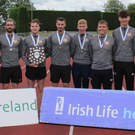 From left: Paddy Morgan (manager), Michael Bowler (international decathlete), Aedan Rodgers (middle distance), Peter O'Connor (multi-events), Adam Fitzhenry (100,200 and 400m), Joe Mooney (international race walker), Chris St. Claire Johnson (400m specialist), Rory Cassidy (middle distance), Pádraig Hore (discus and shot specialist), Ryan Carthy-Walsh (high jump specialist), Peter O'Shea (javelin specialist), Annemarie Forde (manager), Nicky Cowman (Athletics Wexford President). Missing from photograph: Eamonn McEvoy (hammer and weight), Jack Forde (multi events), Tom Furlong (hammer), James Hanlon (race walker)