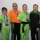 The members of Wexford Kung Fu and Kickboxing Club who were successful in the U.S.A. (from left): Nathan Casserly, Pat Monahan (referee), Michelle Casserly, Bobby O'Neill (coach), Cathal Moran, Adam Tierney, Eoghan Dempsey, Mark Rowe (coach)