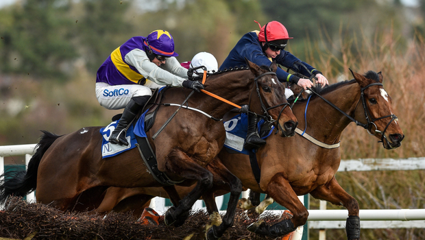 Latest Exhibition (left), with Bryan Cooper on board, jump the last ahead of Longhouse Poet, ridden by Jamie Codd, on their way to winning The Nathaniel Lacy & Partners Solicitors€50,000 Cheltenham Bonus For Stable Staff Novice Hurdle at Leopardstown