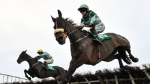 Alfa Mix, left, with Jonathan Moore on board, jumps the last,alongside eventual third place Drumacoo, ridden by Rachael Blackmore, on their way to winning the Tara Handicap Hurdle at Navan