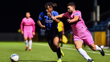 Malike Benrouguibi of Wexford FC battling for the ball with Athlone Town's Tumelo Tlou