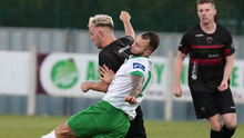 Charlie Smith (Wexford FC) is challenged by Daniel Blackbyrne of Cabinteely
