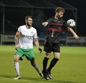 Goalscorer Conor English shields the ball from Cabinteely captain Kevin Knight