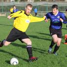 Dylan Egan of New Ross Celtic tries to shake off the attentions of Conor Fortune