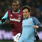 Manchester City's David Silva is tracked by Angelo Ogbonna of West Ham during their FA Cup tie