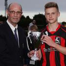 Willie Cottrell presenting the Under-16 Cup to Gorey Rangers captain, Luke Green