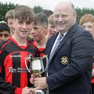Gorey Rangers captain Ryan Connolly gets the cup from Don Hearne