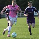 Orla Casey of Wexford Youths racing clear of Dearbhaile Beirne (UCD Waves) in Saturday's semi-final