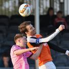 Conor Sutton tussles in the air with Athlone's Walter Invernizzi