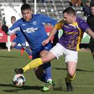 Shane Dempsey of Wexford shields the ball from the A.U.L. defender John Lester