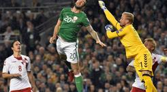 Shane Duffy heading the Republic of Ireland in front against Denmark. Photograph: Mick Harpur.