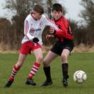 Tom Wheatley (Gorey Rangers) battling with Ryan Carroll