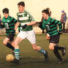 Darragh Farrell of Shamrock Rovers is pursued by Gorey Celtic duo Cian Hughes and Josh Whyte