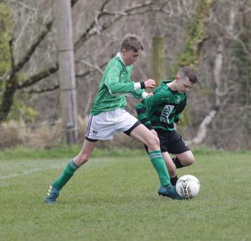 Reuben Lafferty of Forth Celtic nicks the ball away from Gorey Celtic's Ryan Callaghan