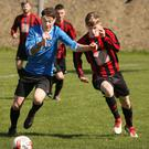 Cormac Moore of Courtown Hibs and Conor Casserly of Gorey Rangers in a race for possession